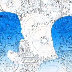 Zwei Blaue Köpfe Und Graue Zahnräder Als Symbol Für Geistige Arbeit Bei Der Innovation