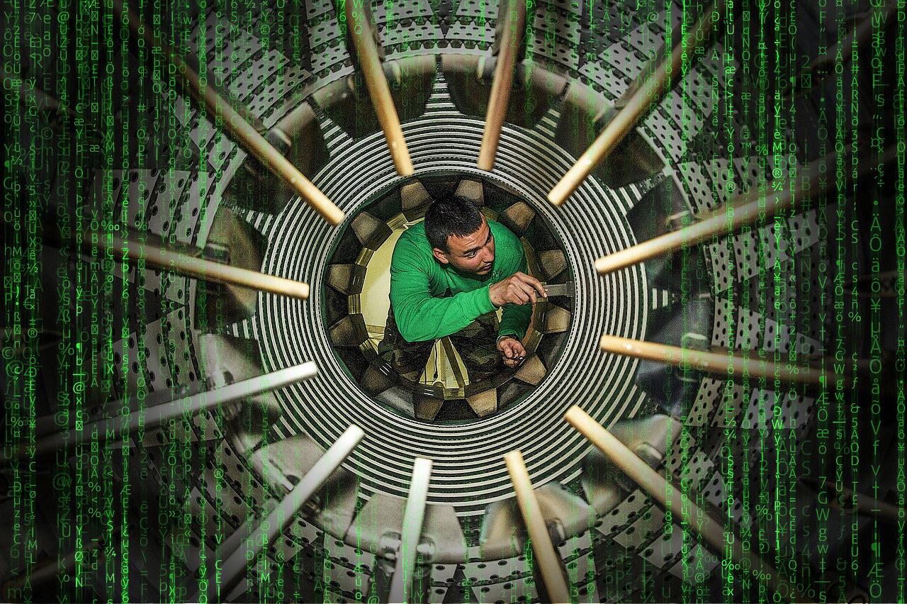 Wartungstechniker schraubt in einer Turbine als Beispiel für eine Service-Innovation der Innovationsarten