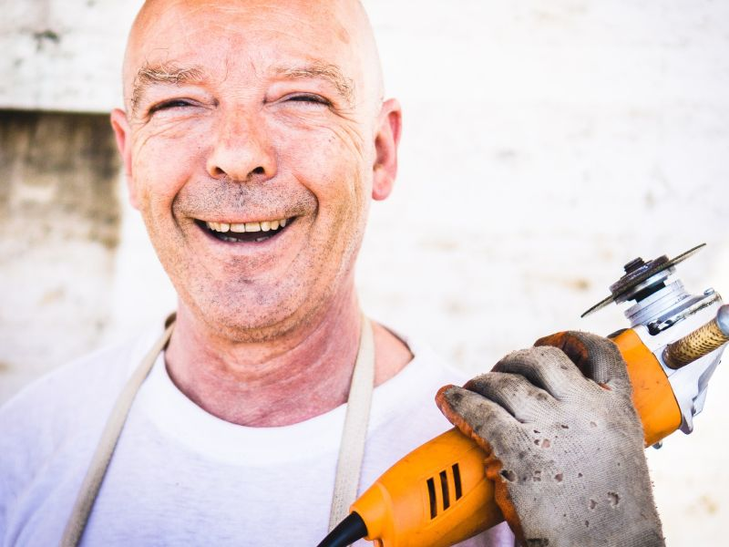 Laughing craftsman with Flex as a symbol for business model innovation Tool sharing - TOM SPIKE