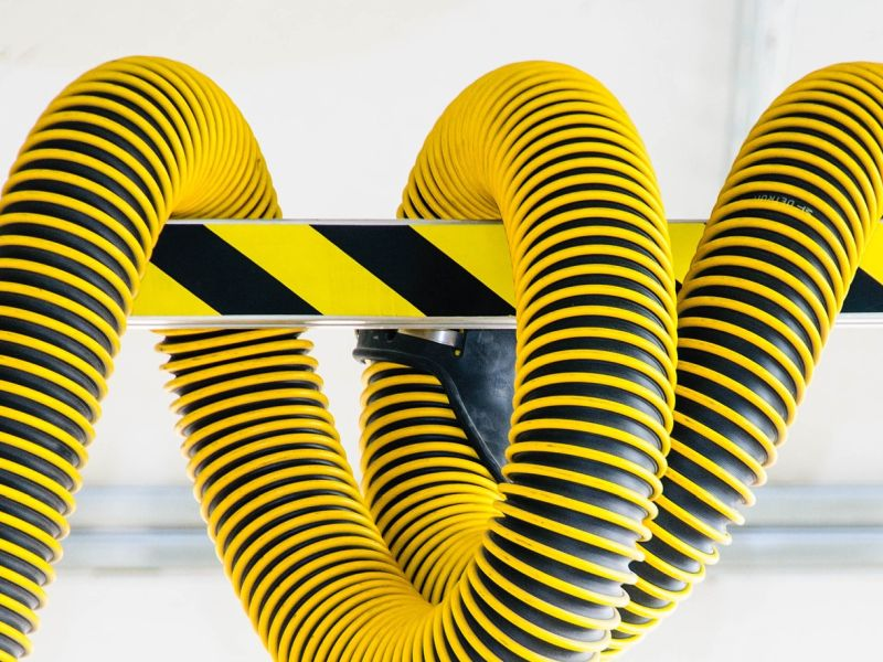 Yellow black plastic hose as a symbol for Technology Innovation - TOM SPIKE